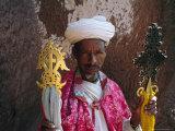 Portrait of a Man Holding Christian Symbols, Bieta Mercurios, Wollo Region, Ethiopia Photographic Print by Bruno Barbier