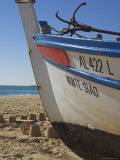 Traditional Fishing Boat and Sand Castles, Fishermans Beach, Albufeira, Algarve, Portugal Photographic Print by Neale Clarke