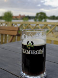 Vilkmerges, Lithuanian Dark Beer, with Trakai Castle in the Background, Lithuania Photographic Print by Gary Cook