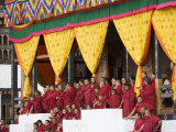 Buddhist Monks Watching Festival (Tsechu), Trashi Chhoe Dzong, Thimphu, Bhutan Photographic Print by Angelo Cavalli