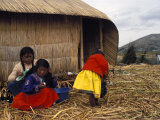 Small Group of Women and Girls of the Uros People on the Floating Reed Islands, Lake Titicaca, Peru Photographic Print by Mark Chivers