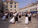 Tourist Board Folk Dancers in Lusa Square, Dubrovnik, Dalmatia, Croatia Photographic Print by Peter Higgins