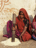 Woman Pounding Food in Village Near Deogarh, Rajasthan State, India Photographic Print by Robert Harding