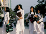 School Girls Facing Ho Chi Minh Statue, Ho Chi Minh City (Saigon), Vietnam, Indochina Photographic Print by Alain Evrard