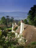 Thatched Cottages at Selworthy Green, with Exmoor Beyond, Somerset, England, United Kingdom Photographic Print by Chris Nicholson
