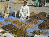 Man Selling Dates at the Market, Erfoud, Morocco, North Africa, Africa Photographic Print by Tony Gervis