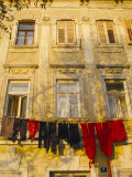 Washing Line of Colourful Laundry in Old Town Buzet, Hilltop Village, Buzet, Istria, Croatia Photographic Print by Ken Gillham