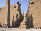 Colossi of Rameses II, Luxor Temple, Luxor, Unesco World Heritage Site, Thebes, Egypt Photographic Print by Peter Scholey