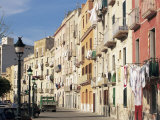 House Fronts and Laundry, Trapani, Sicily, Italy Photographic Print by Ken Gillham