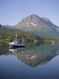 Boat and Mountains Reflected in Tranquil Water, Near Tromso, North Norway, Norway Photographic Print by David Lomax