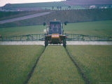 Spraying Pesticides on Crops in Fields, Cambridgeshire, England, United Kingdom Photographic Print by David Lomax