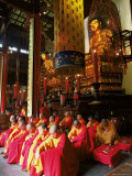 Buddhist Monks Worshipping in the Grand Hall, Jade Buddha Temple (Yufo Si), Shanghai, China Photographic Print by Gavin Hellier