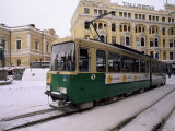 Tram in Street in Winter, Helsinki, Finland, Scandinavia Photographic Print by Gavin Hellier