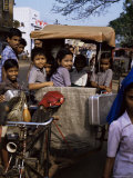 Schoolchildren in Cycle Rickshaw, Aleppey, Kerala State, India Photographic Print by Jenny Pate