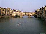 Skiff on the River Arno and the Ponte Vecchio, Florence, Tuscany, Italy Photographic Print by Walter Rawlings