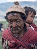 Old Man Carrying Child, Bhutan, Photographic Print
