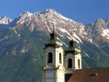 Church with Mountain Backdrop, Innsbruck, Tirol (Tyrol), Austria Photographic Print by Gavin Hellier