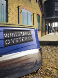 Oyster Boat Outside the Oyster Stores on the Seafront, Whitstable, Kent, England Photographic Print by David Hughes