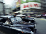 Taxis in Piccadilly Circus, London, England, United Kingdom Photographic Print by Lee Frost