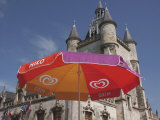 Umbrella Advertising Ice Cream, with Gothic Town Hall Behind, Rue, Somme, Picardy, France Photographic Print by David Hughes