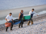 Fisherman Carrying Fish up Shingle Beach, Le Hourdel, Cote Picardie, Picardy, France Photographic Print by David Hughes