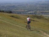 Mountain Biker on Public Bridleway, Cleeve Hill, the Cotswolds, Gloucestershire, England Photographic Print by David Hughes