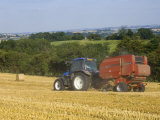 Tractor Collecting Hay Bales at Harvest Time, the Coltswolds, England Reprodukcja zdjęcia autor David Hughes