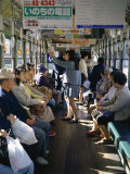 Passengers, Interior a Public Tram, Nagasaki, Island of Kyushu, Japan Photographic Print by Christopher Rennie