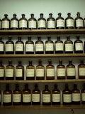 Shelves of Old Essence Bottles, Parfumerie Fragonard, Grasse, Alpes Maritimes, Provence, France Photographic Print by Christopher Rennie