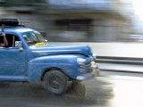 Panned Shot of Old American Car Splashing Through Puddle on Prado, Havana, Cuba, West Indies Photographic Print by Lee Frost