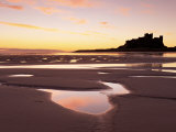 Bamburgh Castle in Silhouette at Sunrise, with Rock Pools on Empty Beach, Northumberland, England Photographic Print by Lee Frost