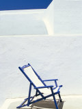 Deckchair Against Whitewashed Wall, Imerovigli, Santorini (Thira), Cyclades Islands, Greece Photographic Print by Lee Frost