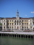 Ayuntamiento (Town Hall) on the Bank of the Bilbao River, Bilbao, Euskadi (Pais Vasco), Spain Photographic Print by Christopher Rennie