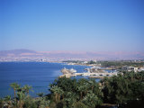 View Over Red Sea Resort Marina and Beach Hotels Towards Israeli Town of Eilat, Aqaba, Jordan Photographic Print by Christopher Rennie