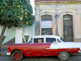 Old American Car Parked on Street Beneath Fruit Tree, Cienfuegos, Cuba, Central America Photographic Print by Lee Frost