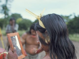 Suya Indian Admiring Lip Disk in Mirror, Brazil, South America Photographic Print by Robin Hanbury-tenison