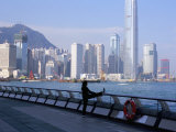Morning Exercise, Victoria Harbour and Hong Kong Island Skyline, Hong Kong, China Photographic Print by Amanda Hall