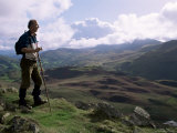 Hill Walker in the Snowdonia National Park, Gwynedd, Wales, United Kingdom Photographic Print by Duncan Maxwell