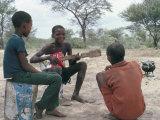 Bushman Boys, Kalahari, Botswana, Africa Photographic Print by Robin Hanbury-tenison
