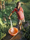 Boy at Water Tap, Chuka Village, Mount Kenya, Kenya, East Africa, Africa Photographic Print by Duncan Maxwell