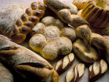 Breads Including Kugelhopfs, Pretzels and Plaited Bread, Alsace, France Photographic Print by John Miller