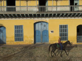 Man Riding Horse Past the Galeria Del Arte (Art Gallery), Plaza Mayor, Trinidad, Cuba Photographic Print by Eitan Simanor
