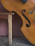 A Counterbass Leaning Against a Wooden Table, Trinidad, Sancti Spiritus Province, West Indies Photographic Print by Eitan Simanor