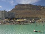 People Floating in the Sea and Hyatt Hotel and Desert Cliffs in Background, Dead Sea, Middle East Photographic Print by Eitan Simanor