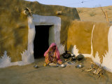 Woman Cooking Outside House with Painted Walls, Village Near Jaisalmer, Rajasthan State, India Photographic Print by Bruno Morandi