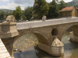 Couple on the Latin Bridge, Across the River Miljacka, Sarajevo, Bosnia, Bosnia-Herzegovina Photographic Print by Graham Lawrence