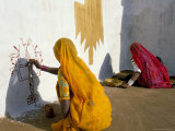 Women Painting Design on a Wall in a Village Near Jaisalmer, Rajasthan State, India Photographic Print by Bruno Morandi