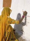 Woman Painting Design on a Wall in a Village Near Jaisalmer, Rajasthan State, India Photographic Print by Bruno Morandi