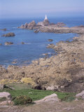 Lighthouse from Cliffs at Low Tide, Corbiere, St. Brelade, Jersey, Channel Islands Photographic Print by David Hunter
