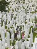 Muslim Woman and Child Tend a Grave at a War Cemetery, Sarajevo, Bosnia, Bosnia-Herzegovina Photographic Print by Graham Lawrence